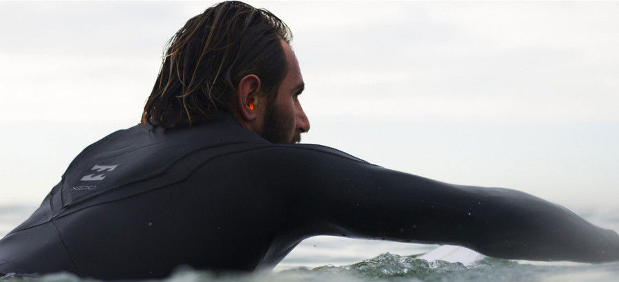 Why do surfers wear earplugs?